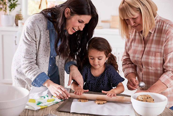 mothers day gift ideas baking cookies with mother and grandmother